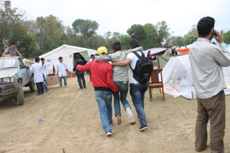 Patient being taken into the field hospital